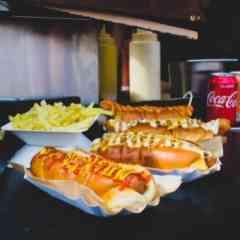 Logo - Thomann´s Ässtruckli - Frisch belege Bagel, American Style Hot Dogs und original Deutsche Currywürste  Berlin Style