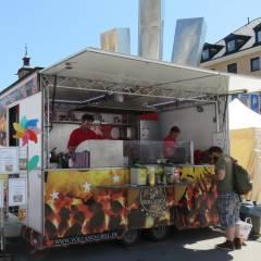 Logo - Volcano Grill - Wir haben uns auf bayerische Schmankerl spezialisiert: Zum Beispiel: Ochs/Spanferkel/Lamm am Holzkohlengrill, Bratwurst, Schaschlik und Steaks.
