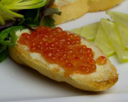 Grenki with red caviar