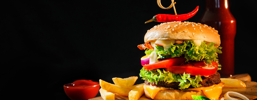 Hamburger french fries vegetables black background 540048 2560x1600