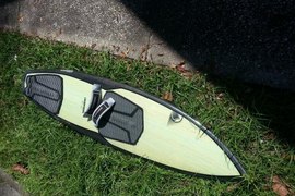 Used twice. Carbon fiber construction and quad fin  ...