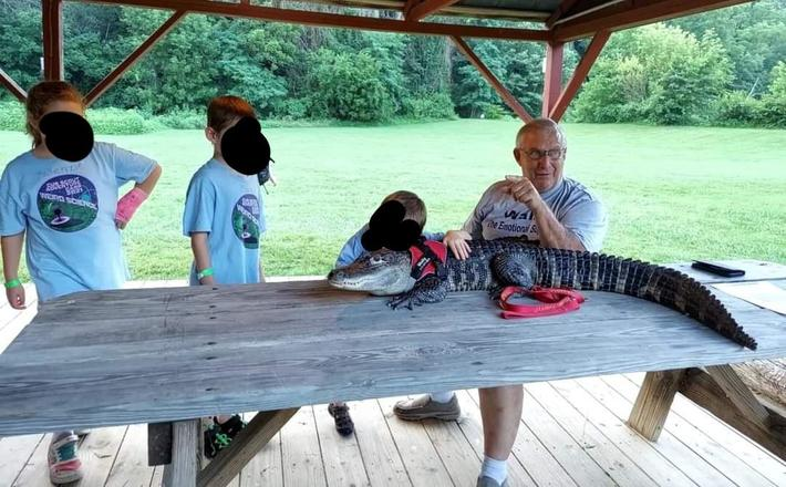 Our Cub Scouts met a man with an emotional support alligator named Wally.