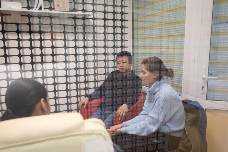 Лі Вей (в центрі) з адвокаткою та перекладачкою, Київ, 8 жовтня 2019 року