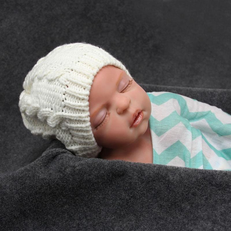 Зимняя шапочка для новорожденного связать