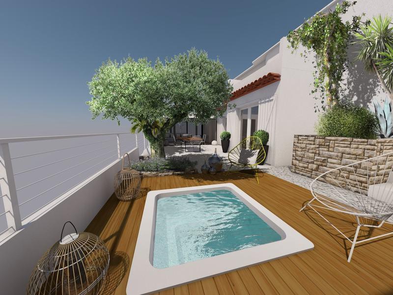 le spa sur une petite terrasse en bois permet de se rafraîchir en journée et se réchauffer le soir.