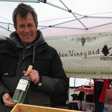 Frithsden vineyard Simon and bottle of wine March 2015