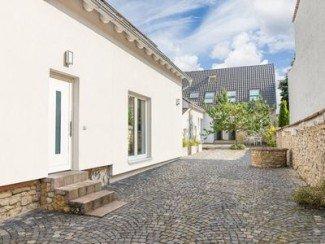 """""""Brunnenhaus"""": maison de vacances élégante avec un jardin géant au milieu de Mayence-Finthen"""