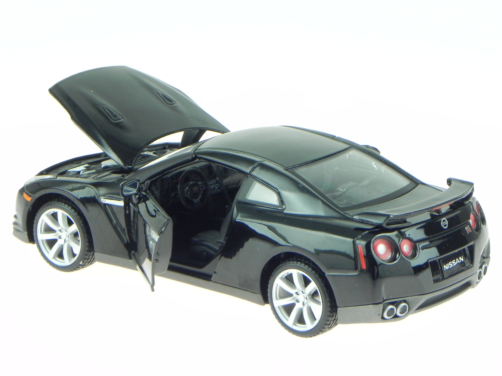 nissan gt r 2009 schwarz modellauto 31294 maisto 1 24 ebay. Black Bedroom Furniture Sets. Home Design Ideas