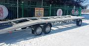 Трёхосный новый прицеп под перевозку авто Колёса В Подарок Дніпро