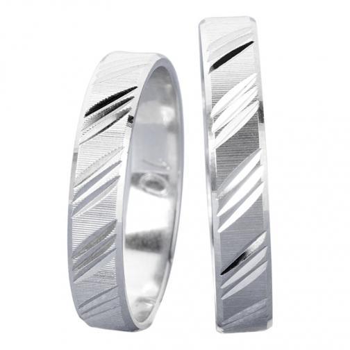 Aby White - snubní prsteny v bílém zlatě s šikmým rytím