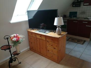 Blick von der Sitzecke in den Küchenbereich