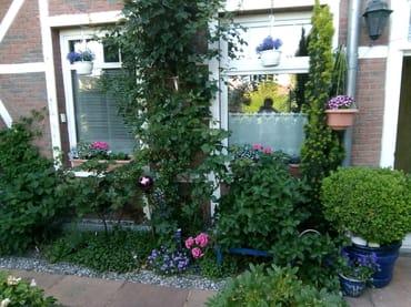 Außenansicht, Bad und Küche vom Garten aus