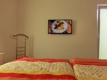 Fernsehen vom Bett aus