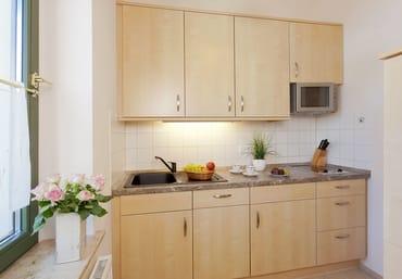 Die separate Küche ist mit allem ausgestattet ist, was Sie für die Zubereitung Ihrer Lieblingsspeisen benötigen.
