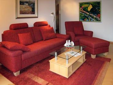 das Wohnzimmer mit gemütlicher Sitzgruppe