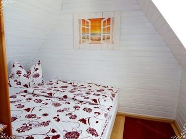 Schlafraum mit Dachfenster