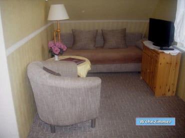 Wohnzimmer mit Doppelbettcouch
