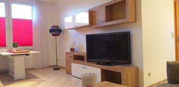 Wohnkombination im Wohnzimmer mit Flachbildschirm