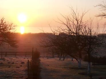 Sonnenaufgang über dem  Bodden von unserer FW aus zu sehen