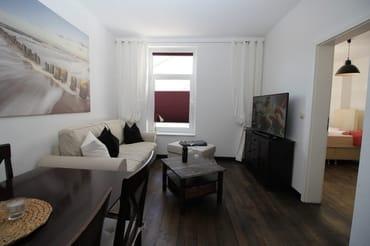 Wohnzimmer mit ausziehbarem Sofa...