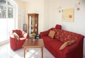 Wohnzimmer mit (verwandelbarer) Relaxcouch