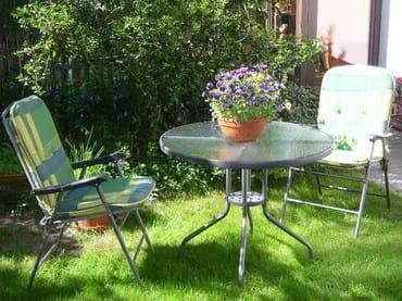 Sitzplatz mit Grillmöglichkeit im Garten