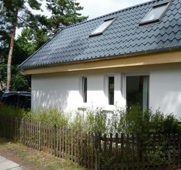 Ferienhaus mit Terrasse und Gartenanteil