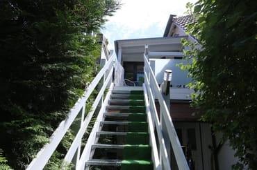Aufgang vom Garten zu Ihrem Apartement