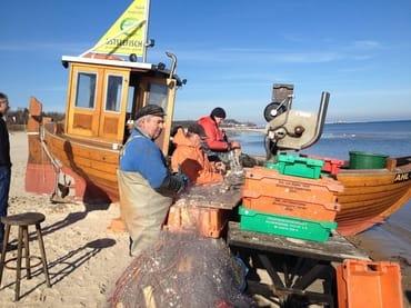 Ostseefischer mit ihrem Fang
