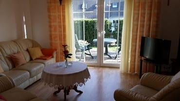 Wohnzimmer + Zugang Terrasse