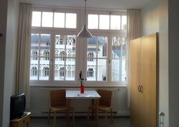 Unser kleinstes Appartement D205 Typ D305 verfügt über die Fensterfront des ehemaligen Wintergartens.