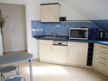 Vollkomfortküche mit Eßecke u. Zugang zum Wohnzimmer