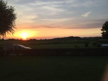 Sonnenuntergang vom Balkon der Wohnung