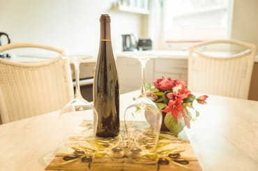 Flasche Wein zur Begrüßung