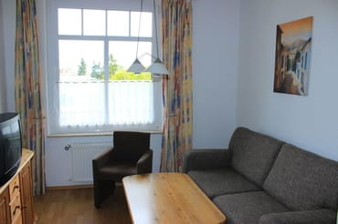 Wohnbereich mit FlatTV