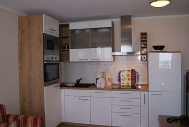 Die neue Einbauküche. Hier kann man kochen - wenn man nicht lieber in den Restaurants links und rechts vom Seehof sich verwöhnen lassen will.
