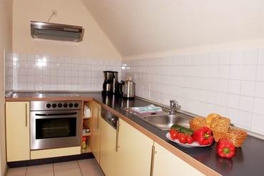 Kleine Küche, funktionell und gut ausgestattet