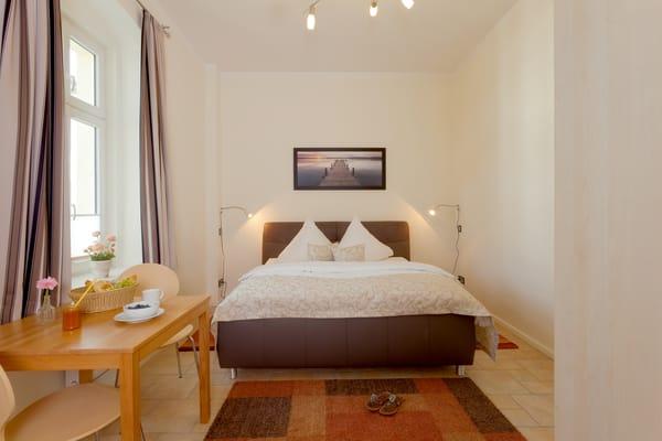 Das zweite Schlafzimmer bietet dank seines Doppelbettes ebenfalls zwei weitere Schlafmöglichkeiten.