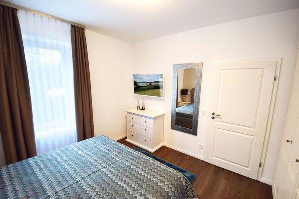 Schlafzimmer mit zusätzlichem Flachbild-TV