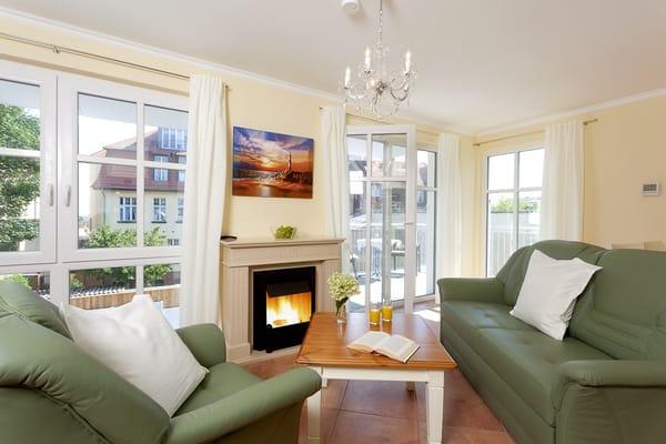 Das mit Liebe eingerichtete Appartement für 2-3 Personen entspricht dem heutigen gehobenen Komfort. Im Wohnzimmer mit einladender Ledergarnitur vor dem Gas-Kamin...