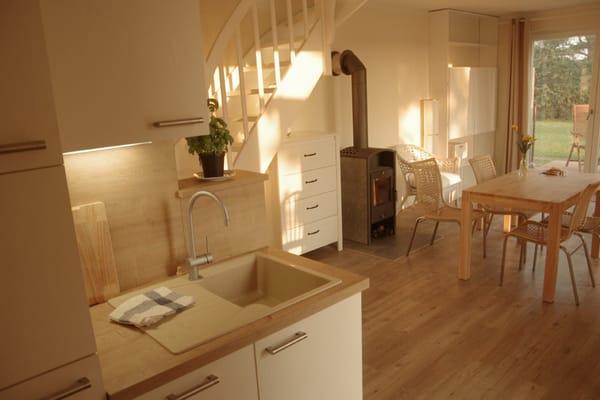 Wohnen mit Kamin, moderner Küche