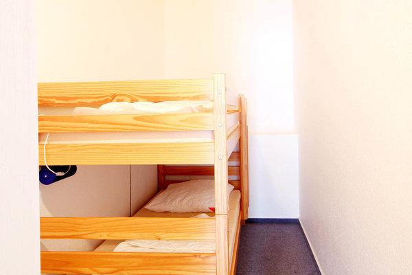 Der 2. Schlafraum ist mit einem Doppelstockbett ausgestattet.