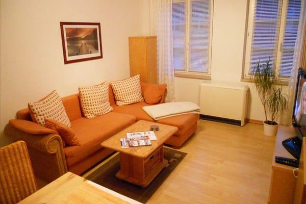 Das Wohnzimmer mit Sitzgruppe