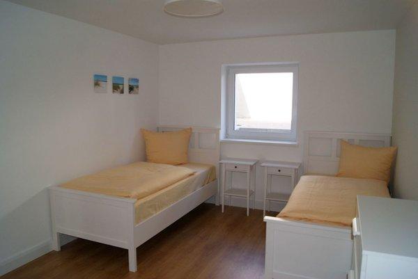 Das Schlafzimmer mit zwei Einzelbetten.