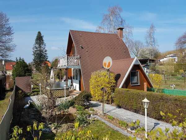 Das idyllische gelegene Finnhaus ist umgeben von viel Grün