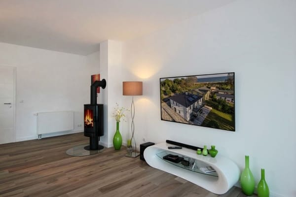 Wohnbereich mit Kamin (Bild 1) im UG