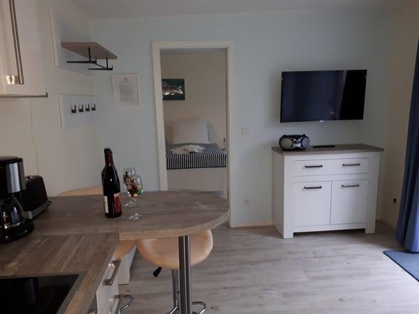 Wohnraum mit Fernseher, CD Player/Radio und kostenfreien WLAN