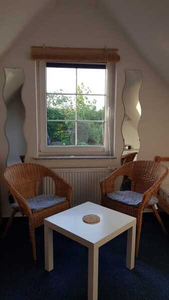Schlafzimmer mit zwei Einzelbetten Ferienwohnung Rügen 3