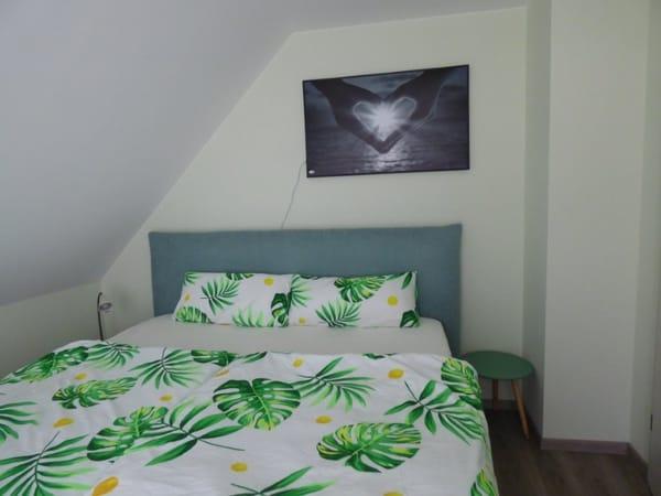 Schlafzimmer 1 OG Bett