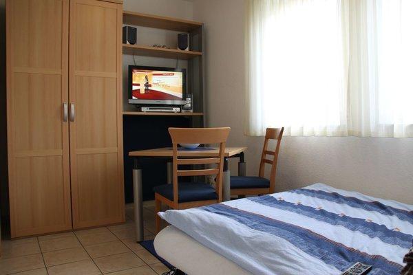 Apartment mit Boxspringdoppelbett